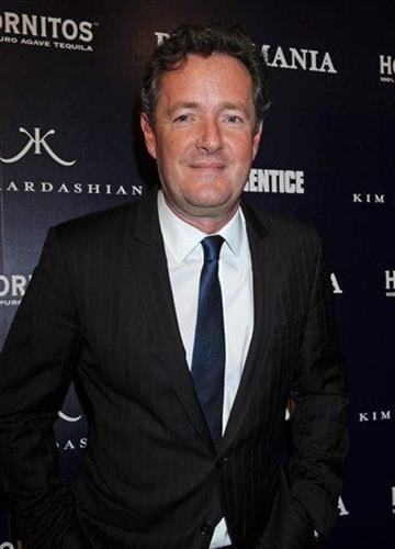 "Piers Morgan arrives for the Perfumania party celebrating the appearance of Kim Kardashian on the reality show ""The Apprentice"", Wednesday, Nov.10, 2010, in New York. (AP Photo/ Louis Lanzano) By Louis Lanzano"