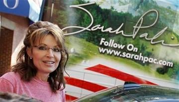 Former Alaska Gov. Sarah Palin stands near her tour bus outside a hotel in Boston, Thursday, June 2, 2011. (AP Photo/Steven Senne) By Steven Senne