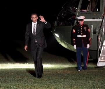 President Barack Obama waves as he walks across the South Lawn of the White House during his return, early Thursday, Aug., 4, 2011 in Washington. (AP Photo/Pablo Martinez Monsivais) By Pablo Martinez Monsivais