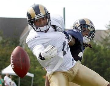 St. Louis Rams wide receiver Brandon Gibson, left, reaches for a pass as cornerback Chris Smith defends during NFL football training camp Thursday, Aug. 4, 2011, in St. Louis. (AP Photo/Jeff Roberson) By Jeff Roberson