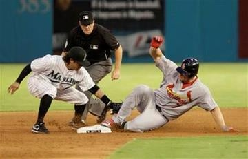 St. Louis Cardinals' Matt Holliday (7) beats the throw to Florida Marlins second baseman Alfredo Amezaga, left, in the third inning during a baseball game in Miami, Saturday, Aug. 6, 2011. (AP Photo/Lynne Sladky) By Lynne Sladky