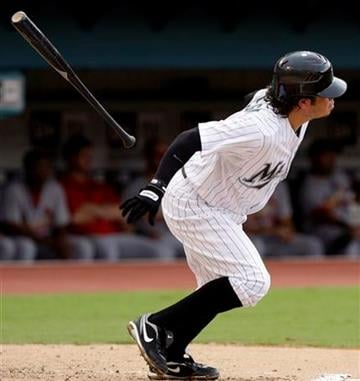 Florida Marlins' Alfredo Amezaga tosses his bat after hitting a single to score Javier Vazquez in the third inning during a baseball game against the St. Louis Cardinals in Miami, Sunday, Aug. 7, 2011. (AP Photo/Lynne Sladky) By Lynne Sladky