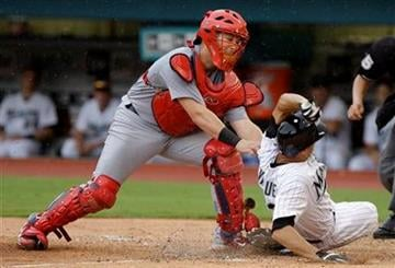 St. Louis Cardinals catcher Tony Cruz, left, tags out Florida Marlins' Javier Vazquez, right, in the fifth inning during a baseball game in Miami, Sunday, Aug. 7, 2011. (AP Photo/Lynne Sladky) By Lynne Sladky