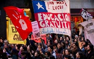 """Argentine and Chilean students march in Buenos Aires, Argentina, Tuesday, Aug. 9, 2011, in support of the student protests in Chile. The large banner at center reads """"free education."""" (AP Photo/Victor R. Caivano) By Victor R. Caivano"""