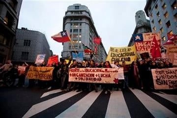 Argentine and Chilean students march in  downtown Buenos Aires, Argentina, Tuesday, Aug. 9, 2011, in support of the student protests in Chile. (AP Photo/Victor R. Caivano) By Victor R. Caivano
