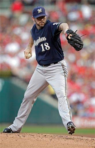 Milwaukee Brewers starting pitcher Shaun Marcum pitches winds up during the first inning of a baseball game against the St. Louis Cardinals, Tuesday, Aug. 9, 2011, in St. Louis.(AP Photo/Tom Gannam) By Tom Gannam