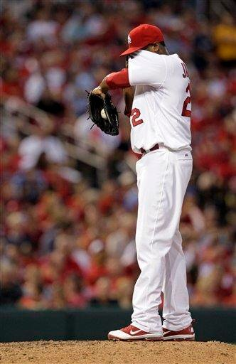 St. Louis Cardinals starting pitcher Edwin Jackson wipes his face after giving up a two-run home run to Milwaukee Brewers' Corey Hart in the third inning of a baseball game, Tuesday, Aug. 9, 2011, in St. Louis.(AP Photo/Tom Gannam) By Tom Gannam