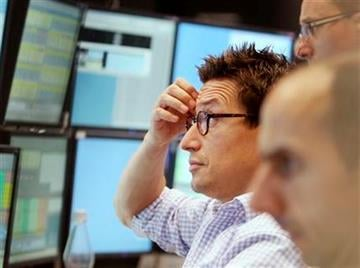 A trader watches his screens at the stock market in Frankfurt, Germany, Tuesday, Aug.9, 2011, where the stock index  DAX went down after the opening of the stock market. (AP Photo/Michael Probst) By Michael Probst