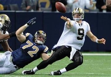 New Orleans Saints quarterback Drew Brees, righ, passes the ball as St. Louis Rams defensive end Chris Long, left, defends during the second quarter of an NFL football game Sunday, Nov. 15, 2009, in St. Louis. (AP Photo/L.G. Patterson) By L.G. Patterson