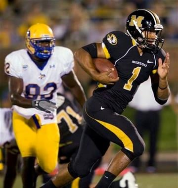 Missouri's James Franklin, right, runs past McNeese State's Brandon Zanders, left, during the third quarter of an NCAA college football game Saturday, Sept. 11, 2010, in Columbia, Mo. Missouri won the game 50-6. (AP Photo/L.G. Patterson) By L.G. Patterson
