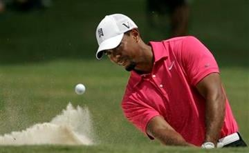 Tiger Woods hits out of a bunker on the ninth hole during the first round of the PGA Championship golf tournament Thursday, Aug. 11, 2011, at the Atlanta Athletic Club in Johns Creek, Ga. (AP Photo/Charlie Riedel) By Charlie Riedel