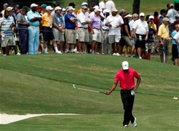 Tiger Woods waits to hit on the eighth hole during the first round of the PGA Championship golf tournament Thursday, Aug. 11, 2011, at the Atlanta Athletic Club in Johns Creek, Ga. (AP Photo/Charlie Krupa) By Charlie Krupa