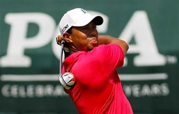 Tiger Woods hits a drive on the first hole during the first round of the PGA Championship golf tournament Thursday, Aug. 11, 2011, at the Atlanta Athletic Club in Johns Creek, Ga. (AP Photo/Matt Slocum) By Matt Slocum