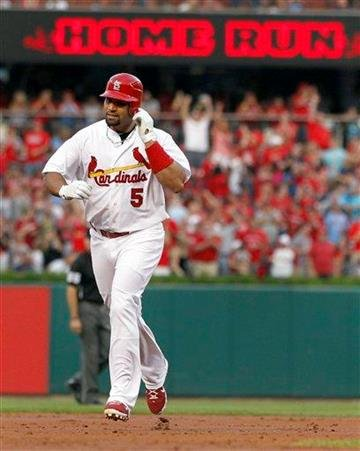 St. Louis Cardinals' Albert Pujols rounds the bases on a solo home run during the first inning of a baseball game against the Milwaukee Brewers Thursday, Aug. 11, 2011, in St. Louis. (AP Photo/Jeff Roberson) By Jeff Roberson