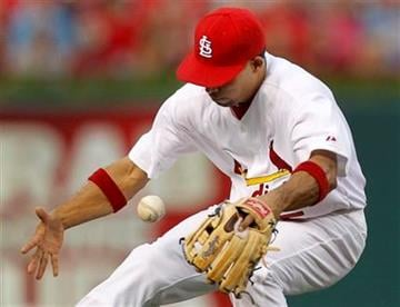 St. Louis Cardinals shortstop Rafael Furcal bobbles a ball hit for a single by Milwaukee Brewers' Yuniesky Betancourt during the second inning of a baseball game Thursday, Aug. 11, 2011, in St. Louis. (AP Photo/Jeff Roberson) By Jeff Roberson