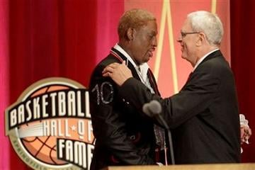 Dennis Rodman, left, is embraced by coach Phil Jackson at Rodman's Basketball Hall of Fame enshrinement during a ceremony in Springfield, Mass., on Friday, Aug. 12, 2011. (AP Photo/Stephan Savoia) By Stephan Savoia
