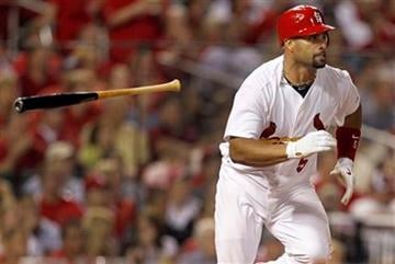 St. Louis Cardinals' Albert Pujols tosses aside his bat as he runs to first on an RBI single during the sixth inning of a baseball game against the Colorado Rockies, Friday, Aug. 12, 2011, in St. Louis. (AP Photo/Jeff Roberson) By Jeff Roberson