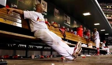 St. Louis Cardinals' Albert Pujols sits in the dugout during the eighth inning of a baseball game against the Colorado Rockies, Friday, Aug. 12, 2011, in St. Louis. (AP Photo/Jeff Roberson) By Jeff Roberson