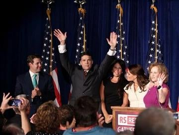 Texas Gov. Rick Perry, surrounded by his family, waves to the crowd after announcing his run for president, Saturday, Aug. 13, 2011 in Charleston, S.C. (AP Photo/Alice Keeney) By Alice Keeney