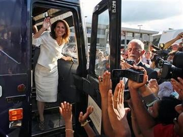 Republican presidential candidate Rep. Michele Bachmann, R-Minn., steps from her campaign bus to greet supporters after winning the Iowa Republican Party's Straw Poll in Ames, Iowa, Saturday, Aug. 13, 2011. (AP Photo/Charles Dharapak) By Charles Dharapak