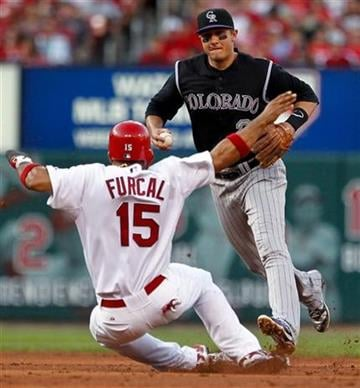 Colorado Rockies shortstop Troy Tulowitzki, right, beats the tag to second base in front of St. Louis Cardinals' Rafael Furcal (15) during the third inning of a baseball game Saturday, Aug. 13, 2011, in St. Louis. (AP Photo/Sarah Conard) By Sarah Conard