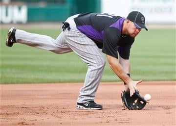 Colorado Rockies third baseman Ty Wigginton fields a ball during batting practice before a baseball game against the St. Louis Cardinals Saturday, Aug. 13, 2011, in St. Louis. (AP Photo/Sarah Conard) By Sarah Conard