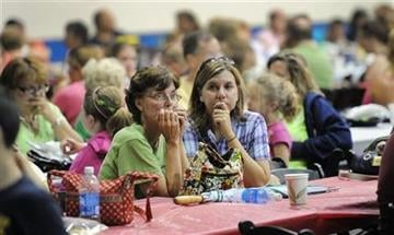 Concert goers sit inside the Pepsi Coliseum after high winds caused the stage collapse before a concert at the Indiana State Fair Grandstands Saturday night, Aug. 13, 2011 in Indianapolis. (AP Photo/The Indianapolis Star, Matt Kryger) By Matt Kryger
