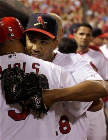 St. Louis Cardinals relief pitcher Octavio Dotel celebrates with teammate Albert Pujols after getting out of a bases loaded jam in the seventh inning of a baseball game, Sunday, Aug. 14, 2011, in St. Louis. (AP Photo/Tom Gannam) By Tom Gannam