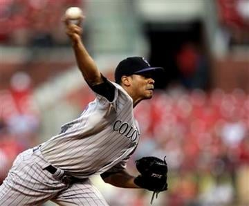 Colorado Rockies starting pitcher Esmil Rogers pitches in the first inning of a baseball game against the St. Louis Cardinals, Sunday, Aug. 14, 2011, in St. Louis.(AP Photo/Tom Gannam) By Tom Gannam