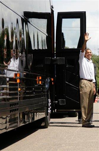 President Barack Obama waves before boarding his bus after having lunch and greeting people at The Old Market Deli, Monday, Aug. 15, 2011, in Cannon Falls, Minn., during his three-day economic bus tour.  (AP Photo/Carolyn Kaster) By Carolyn Kaster