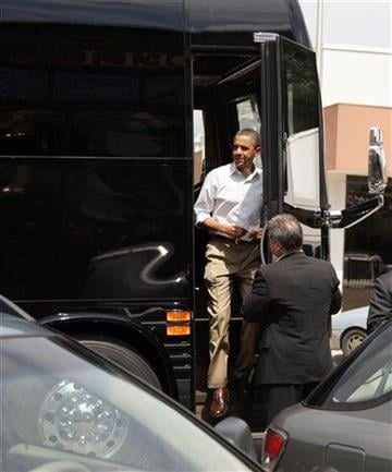 President Barack Obama steps off of his bus as he stops for lunch at The Old market Deli, Monday, Aug. 15, 2011, in Cannon Falls, Minn., during his three-day economic bus tour.  (AP Photo/Carolyn Kaster) By Carolyn Kaster
