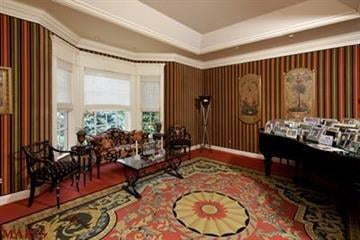 The home is 21 years old and 12,000 square feet with 19 rooms, including four bedrooms By Bryce Moore