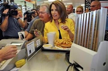 Republican presidential candidate, Rep. Michele Bachmann, R-Minn., pays for her order of  Chili Cheese A/Plenty, Tuesday, Aug. 16, 2011, at the Beacon Drive-in , in Spartanburg, S.C. (AP Photo/ Richard Shiro) By Richard Shiro