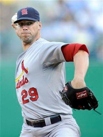 St. Louis Cardinals starting pitcher Chris Carpenter (29) delivers a pitch against the Pittsburgh Pirates during the first inning of a baseball game Tuesday, Aug. 16, 2011 in Pittsburgh.(AP Photo/Don Wright) By Don Wright