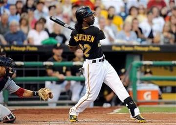 Pittsburgh Pirates' Andrew McCutchen (22) watches the ball clear the wall on a three-run home run against the St. Louis Cardinals during the third inning of a baseball game Tuessday, Aug. 16, 2011 in Pittsburgh.(AP Photo/Don Wright) By Don Wright