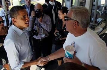 President Barack Obama greets people at DeWitt Dairy Treats, Tuesday, Aug. 16, 2011, in DeWitt, Iowa, during his three-day economic bus tour.  (AP Photo/Carolyn Kaster) By Carolyn Kaster