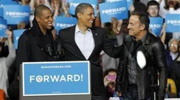 Jay-Z, left to right, President Barack Obama and Bruce Springsteen smile during a campaign event at Nationwide Arena Monday, Nov. 5, 2012, in Columbus, Ohio. (AP Photo/Tony Dejak) By Belo Content KMOV