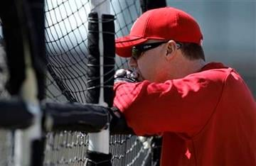 St. Louis Cardinals hitting coach Mark McGwire watches players take batting practice during spring training baseball Thursday, Feb. 18, 2010, in Jupiter, Fla. (AP Photo/Jeff Roberson) By Jeff Roberson