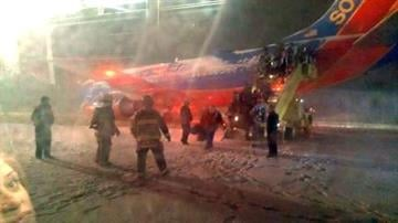 A Twitter user named Brad who said he was aboard Southwest Airlines Flight 1905 when it skidded off the runway at Denver International Airport tweeted this photo of passengers being evacuated. By Dan Mueller