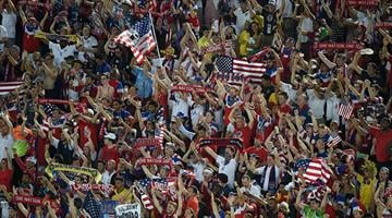 US fans cheer during a Group G football match between Ghana and US at the Dunas Arena in Natal during the 2014 FIFA World Cup on June 16, 2014.  AFP PHOTO / JAVIER SORIANO By JAVIER SORIANO