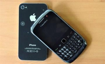 A picture taken on October 12, 2011 in the French western city of Rennes shows a Blackberry phone and an Iphone 4. AFP PHOTO / DAMIEN MEYER (Photo credit should read DAMIEN MEYER/AFP/Getty Images) By DAMIEN MEYER