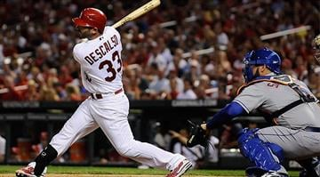 ST. LOUIS, MO - SEPTEMBER 4: Daniel Descalso #33 of the St. Louis Cardinals hits a one run single against the New York Mets at Busch Stadium on September 4, 2012 in St. Louis, Missouri. (Photo by Jeff Curry/Getty Images) By KMOV Web Producer
