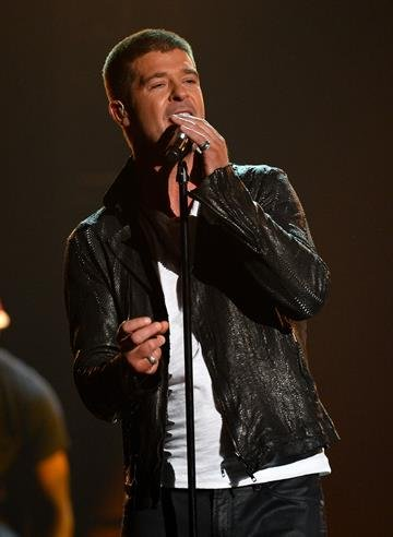 LAS VEGAS, NV - MAY 18:  Singer Robin Thicke performs onstage during the 2014 Billboard Music Awards at the MGM Grand Garden Arena on May 18, 2014 in Las Vegas, Nevada.  (Photo by Ethan Miller/Getty Images) By Ethan Miller