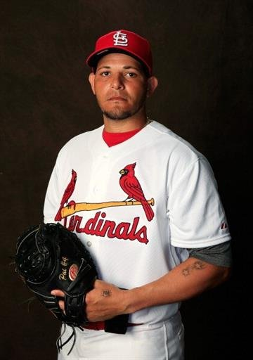 JUPITER, FL - FEBRUARY 24:  Catcher Yadier Molina #4 of the St. Louis Cardinals poses for a portrait during photo day at Roger Dean Stadium on February 24, 2014 in Jupiter, Florida.  (Photo by Rob Carr/Getty Images) By Rob Carr