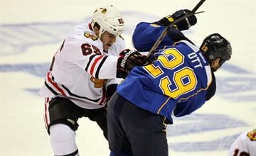 Chicago Blackhawks Andrew Shaw gives St. Louis Steve Ott a wack with his stick during the first period of Game 2 of the Western Conference Playoffs at the Scottrade Center in St. Louis on April 19, 2014. UPI/Bill Greenblatt By BILL GREENBLATT