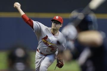 MILWAUKEE, WI - APRIL 16: Joe Kelly #58 of the St. Louis Cardinals pitches during the fourth inning against the Milwaukee Brewers at Miller Park on April 16, 2014 in Milwaukee, Wisconsin. (Photo by Mike McGinnis/Getty Images) By Mike McGinnis