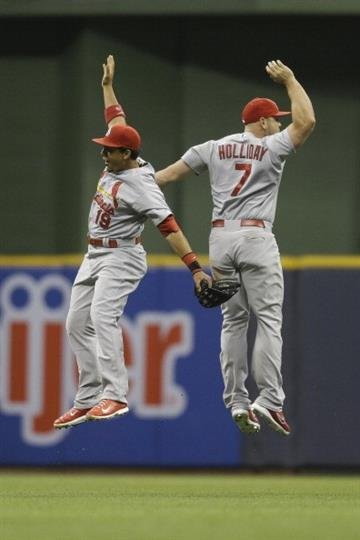 MILWAUKEE, WI - JULY 11: Matt Holliday #7 of the St. Louis Cardinals and Jon Jay #19 celebrate after the 7-6 win over the Milwaukee Brewers at Miller Park on July 11, 2014 in Milwaukee, Wisconsin. (Photo by Mike McGinnis/Getty Images) By Mike McGinnis