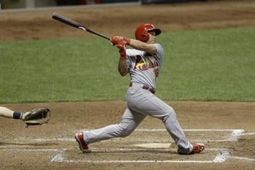 MILWAUKEE, WI - JULY 11: Kolten Wong #16 of the St. Louis Cardinals hits a solo home run in the top sixth inning against the Milwaukee Brewers at Miller Park on July 11, 2014 in Milwaukee, Wisconsin. (Photo by Mike McGinnis/Getty Images) By Mike McGinnis