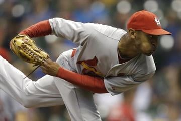 MILWAUKEE, WI - JULY 12: Sam Freeman #71of the St. Louis Cardinals pitches during the bottom of the ninth inning against the Milwaukee Brewers at Miller Park on July 12, 2014 in Milwaukee, Wisconsin. (Photo by Mike McGinnis/Getty Images) By Mike McGinnis