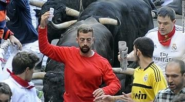 The thin, bearded man, so-far unidentified, faces a fine of about $4,100 (3,000 euros) under new Pamplona city rules that aim to make the globally famous bull running slightly safer. By Stephanie Baumer